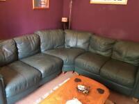 Genuine dark green leather corner sofa and storage poof