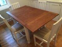 Beautiful dining table and four chairs