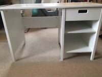 Sturdy white desk with shelf and drawer.