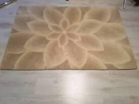 Cream / beige rug 180cm × 120 cm