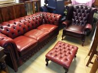 Lovely large three setter and footstool ox blood red chesterfield &high back queen Anne armchair .
