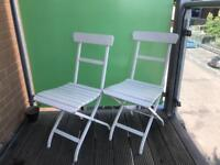 2 White outdoor Chairs