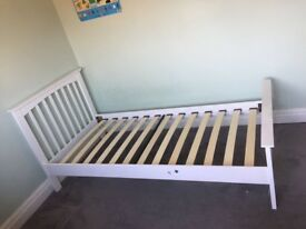 Single White wooden framed bed