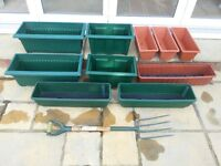 10 garden troughs and trough stand, will sell troughs and stand seperately.