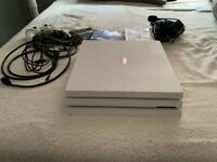 White PS4 with games