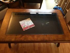 Solid rectangular coffee table, bevelled glass top and drawer for precious items
