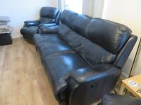 For sale. Black leather reclining three piece suite, excellent condition.