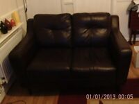 Two seater brown leather settee bought from DFS last year selling to make more room