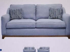 Two light blue 2 seater sofas.
