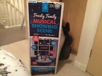 Frosty family musical snowy scene