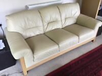 Cream 3 seat leather sofa and 1 Chair.