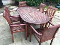 Wooden garden table and six chairs