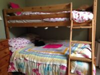 Solid wooden bunk beds, lower bed is a 4ft double.