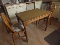 Kitchen table and 2 wooden chairs with cushions