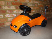 Authentic BMW kids ride on toy car suitable from 1 to 4 years - orange.
