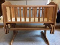 O Baby swinging crib / bassinet in natural wood with very new mattress - good used condition
