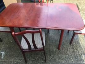 Extendable dining table and 3 chairs