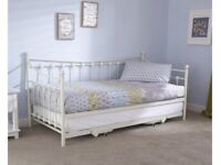 Day bed that makes up into 2 singles or large double bed with mattresses (1 year old lightly used)