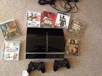 PlayStation 3 with 7 games and 2 controllers