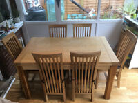 Solid oak dining table and 6 oak chairs