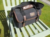 Large Canon bag for all your camera or video equipment. Very good condition.
