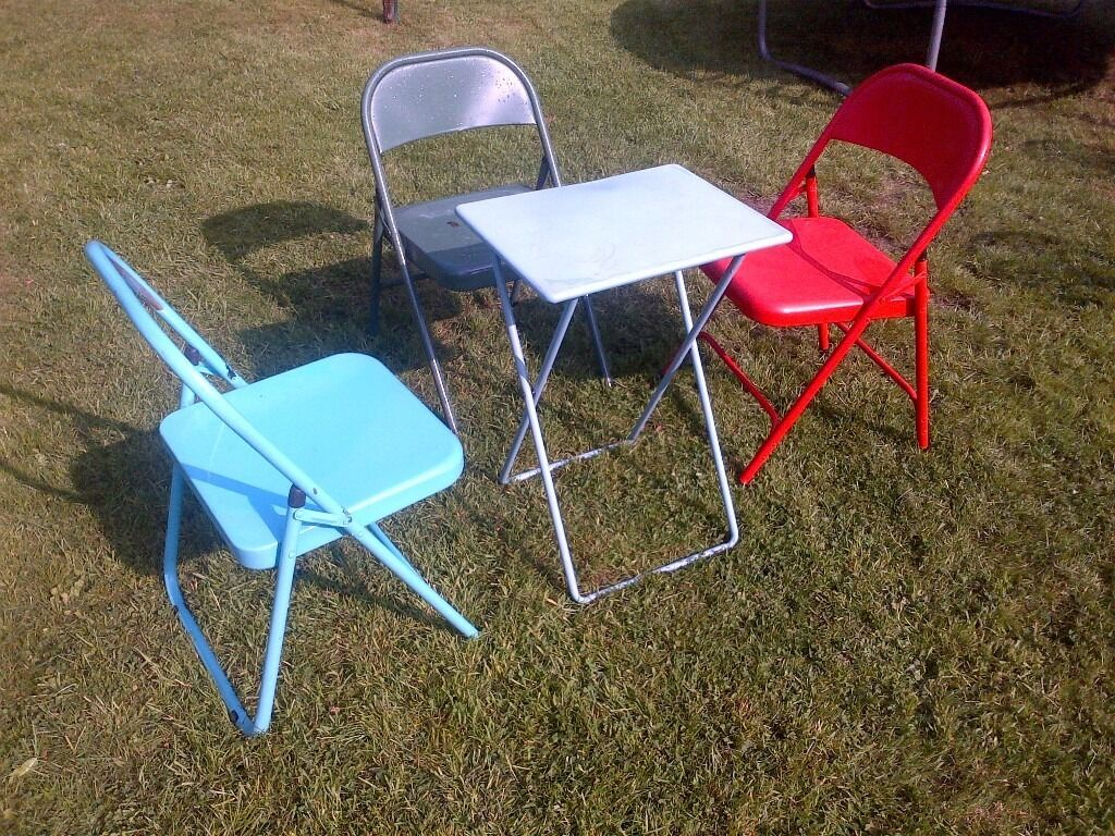 set of colorful folding metal table and chairs