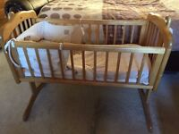 Swinging Crib with bedding set included