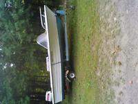 16ft fiberglass boat with 25hp Johnson and trailer
