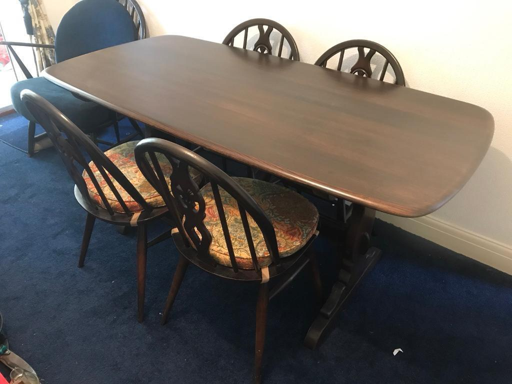 Ercol Table with 4 chairs.