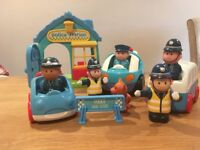 Happyland police station and cars