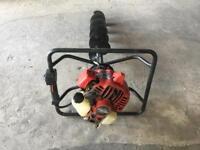 Petrol post hole auger