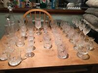 Large collection of cut glass and decanters