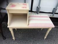 Upholstered painted telephone seat and table