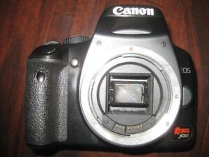 "Canon EOS Rebel XSi DSLR Camera / Camcorder with EF-S 18-55mm IS Lens. CMOS Sensor. 3"" Display. 9 Point Auto Focus"