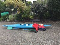 Canoe - Perception kayak with paddle, buoyancy aid, spray deck and skeg.