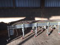 Telescopic roller electric conveyor