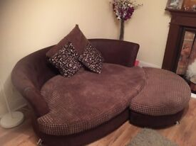 2 seater cuddle couch with footstool . Clean and good condition