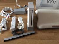 Nintendo Wii + Wii Fit Board + Games