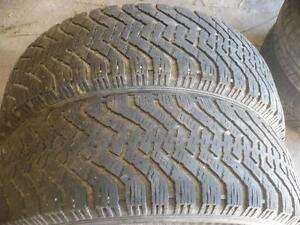 Two  235-65-17 snow tires $90.00