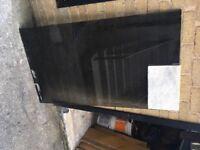 Large sheet of smoked glass. 143 x 81 x 0.9 cms