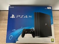 PS4 PRO WITH CONTROLLERS AND GAMES