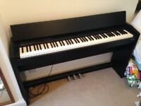 Roland F-140R Digital Piano (Black), good condition + fully functional.