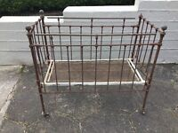 Antique cast iron and brass cot