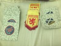 Scotland saw on Badges and pennant