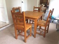 Small solid oak dining table plus 4 chairs.