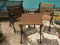 Vintage cast iron chairs newly refurbished with oak
