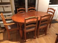 Oval pine table and 6 chairs - will extend to seat 8