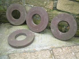 4 round millstones suitable for paving or as plant stands
