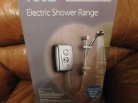 T807 fast fit electric shower. Brand new. White. Collection only