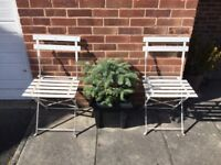 Pair of vintage bistro style metal folding chairs